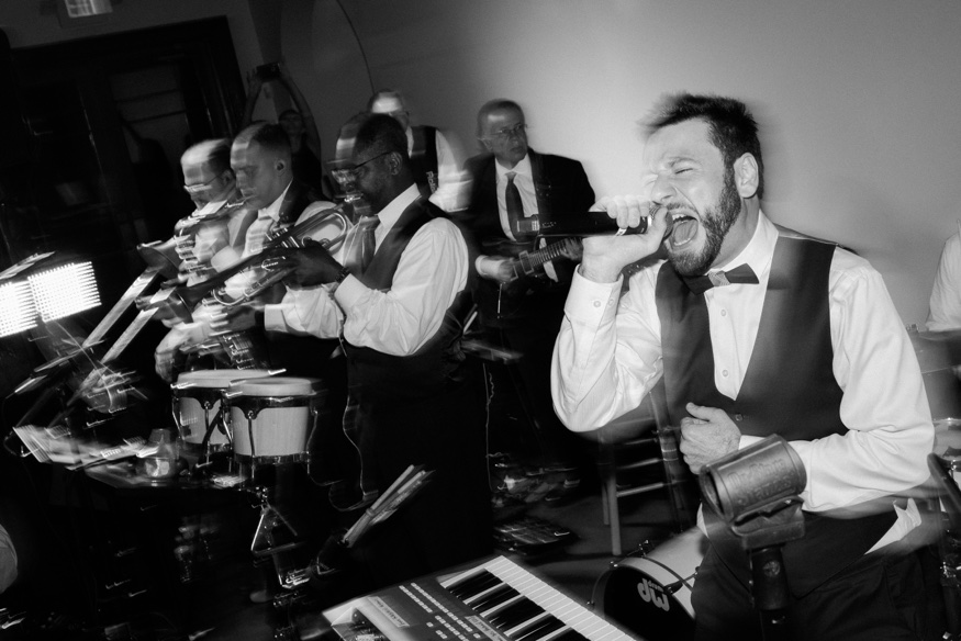 Groom singing with CTO Midtown Express Band at Knowlton Mansion wedding.