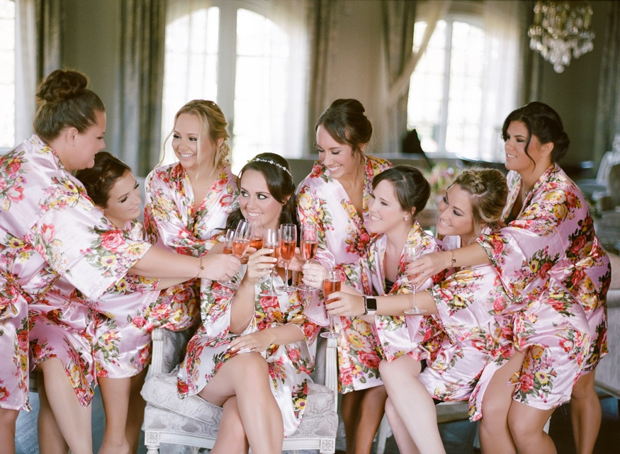 Bride and bridesmaids in matching robes at Park Chateau wedding.