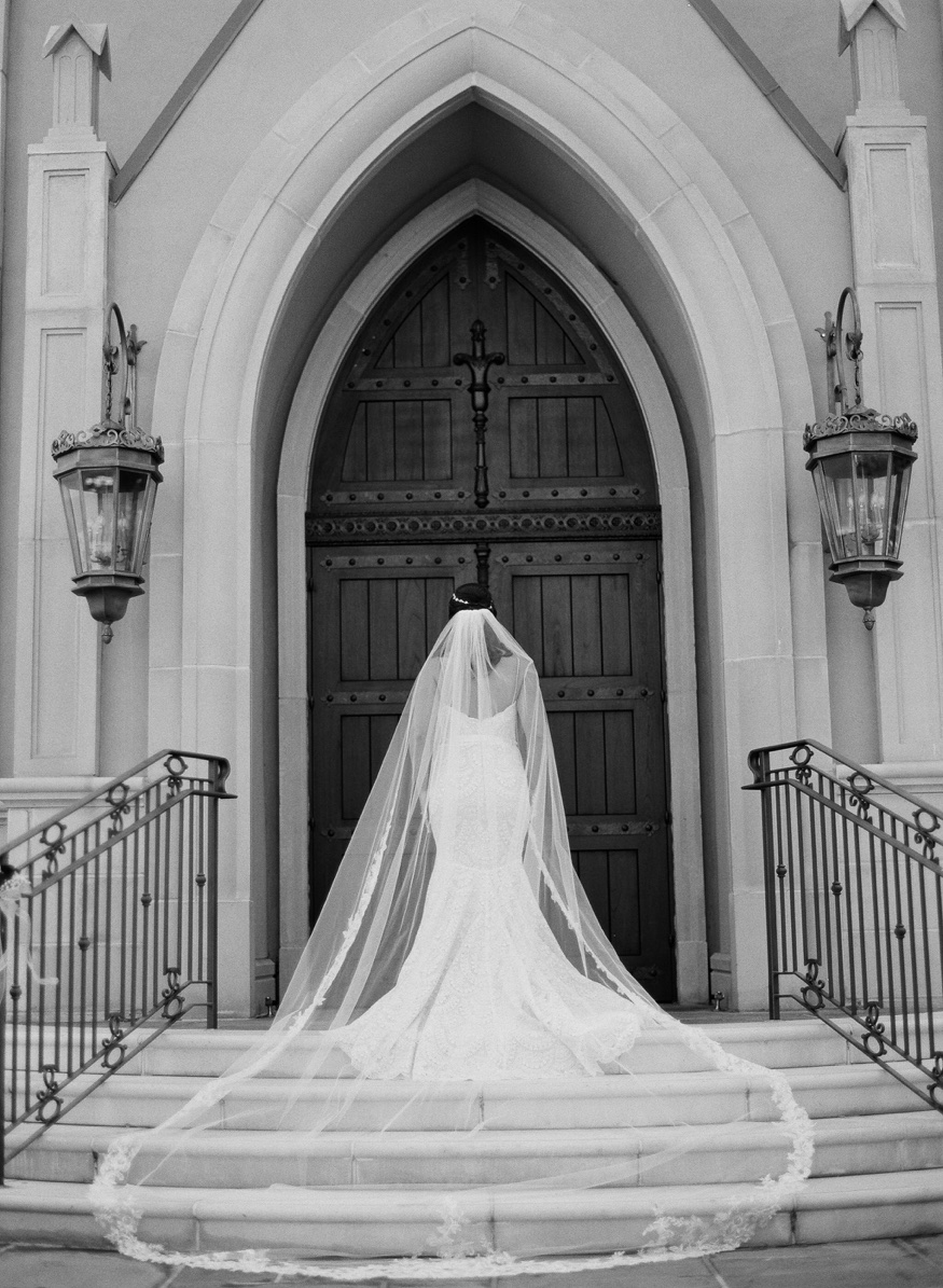 Wedding portraits in front of the chapel at the Park Chateau.