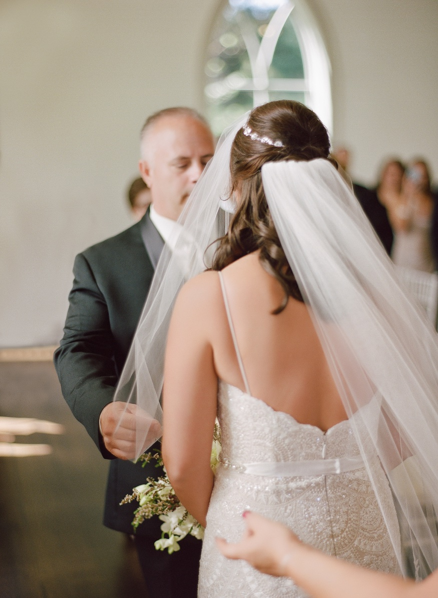 Bride and father walk down the aisle at the Park Chateau wedding ceremony.