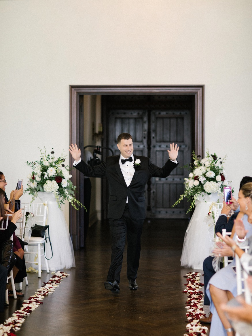 Groom walking down aisle at ceremony at the Park Chateau.