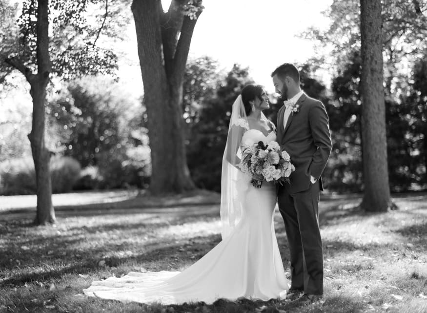 Bride and Groom black and white photo at fall wedding at Knowlton Mansion.