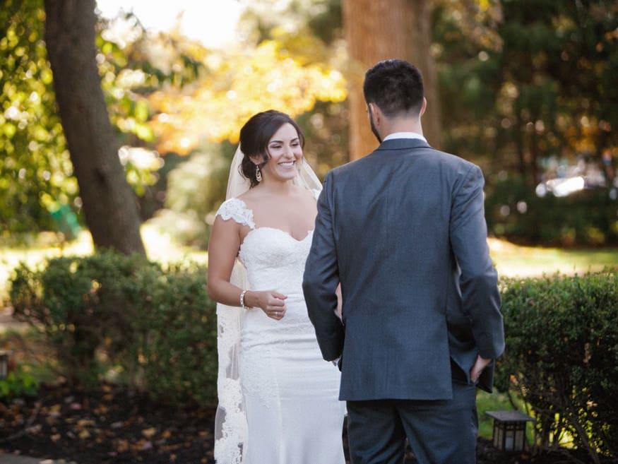 Bride and Groom first look at fall wedding at Knowlton Mansion.