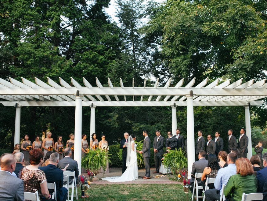 Bride and Groom at outdoor ceremony at knowlton mansion wedding