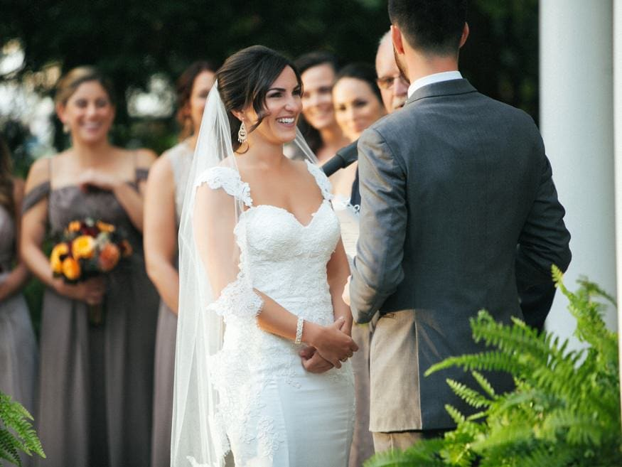 Bride and Groom at outdoor wedding ceremony at Knowlton Mansion.