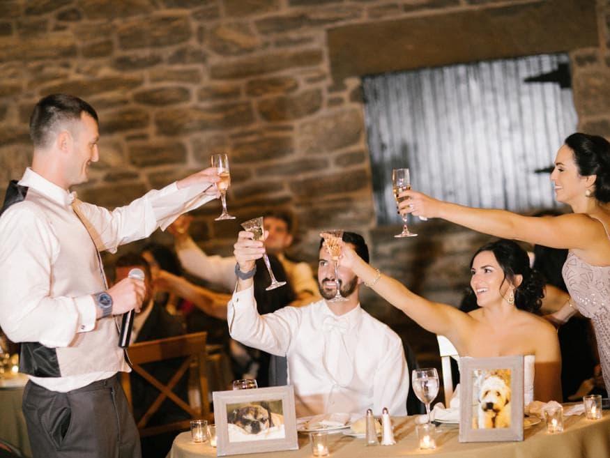 Toasts at fall wedding at Knowlton Mansion.