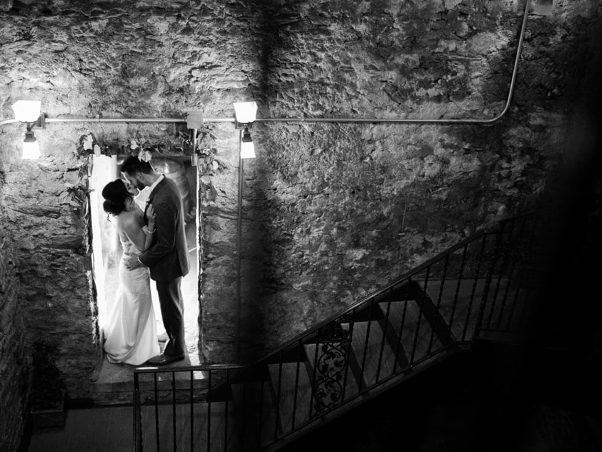 Bride and Groom night portraits in Knowlton Mansion wine cellar.
