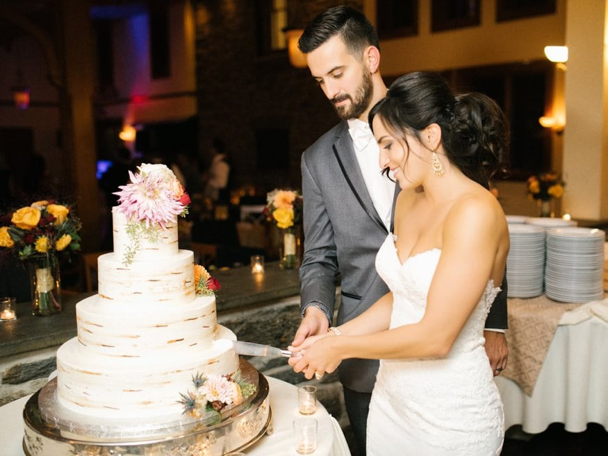 Bride and Groom cutting the cake at Knowlton Mansion wedding.