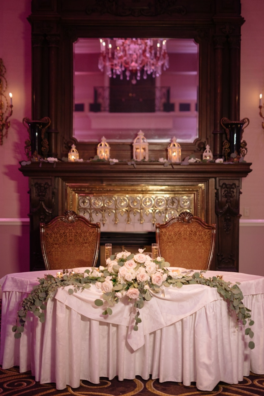 Sweetheart table with flowers by Petal Pushers at Palace at Somerset wedding venue.