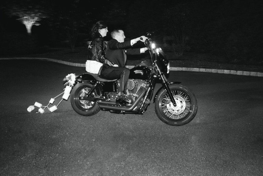 Bride and Groom exiting Palace at Somerset wedding with Harley Davidson and sparklers.