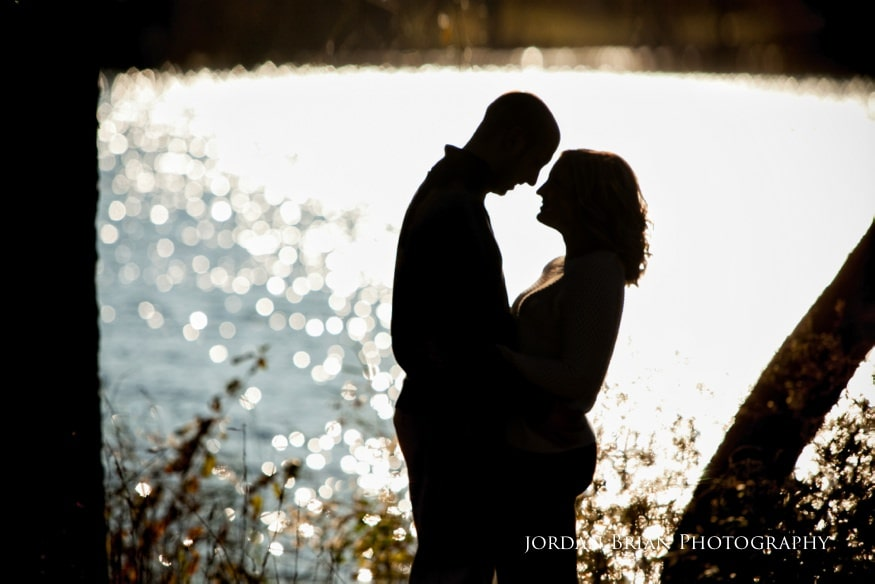 couple by water at fdr park engagement session