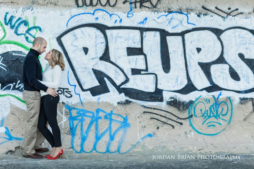 couple infront of graffiti at fdr park engagement session