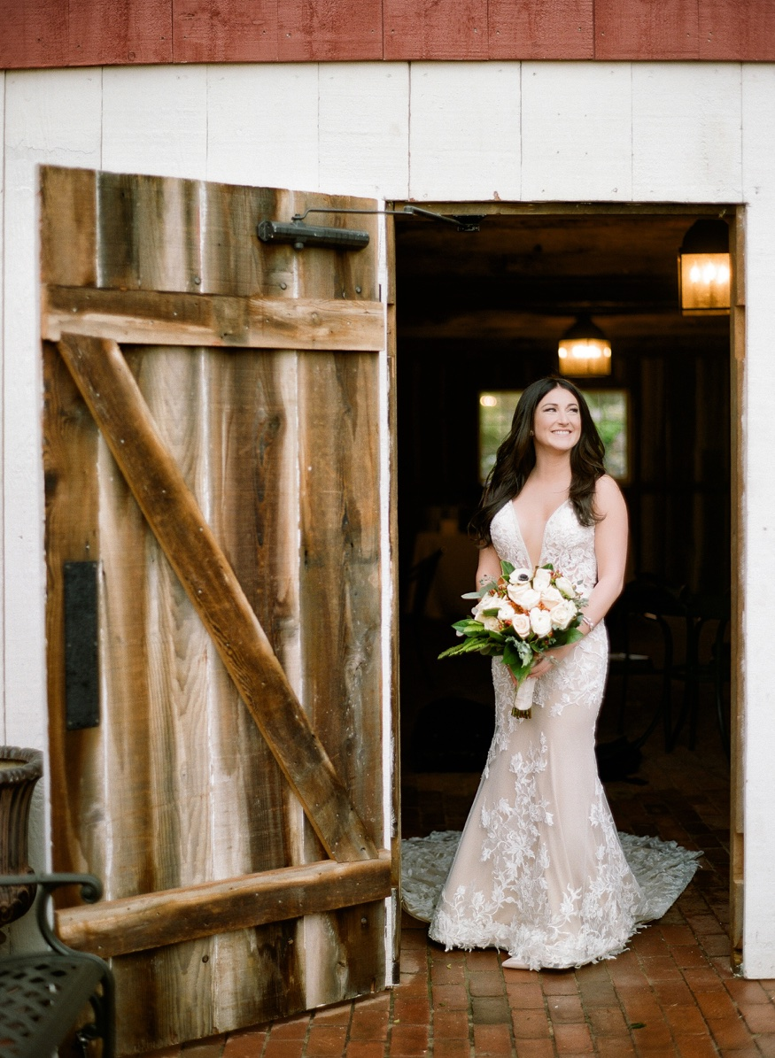 Bride's portraits in the rain at Brandywine Manor House wedding.