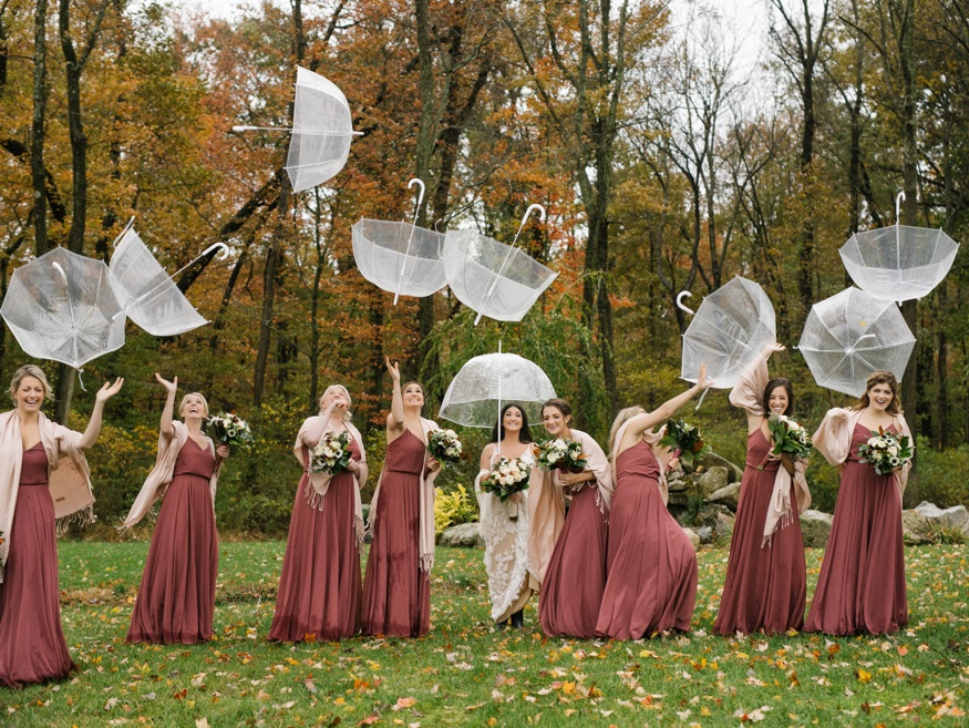 Bridal party portraits in the rain at the Brandywine Manor House wedding.