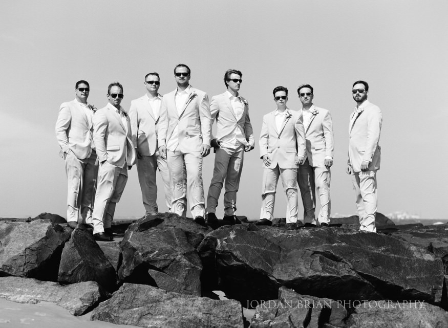 groomsmen on jetty at ocean city yacht club wedding