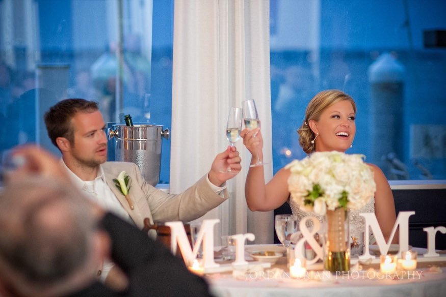 bride and groom toast at ocean city yacht club wedding