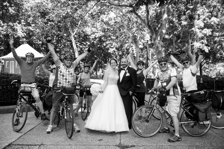 Photobomb with Bride and Groom and cyclist at Washington Square Park in Philadelphia.
