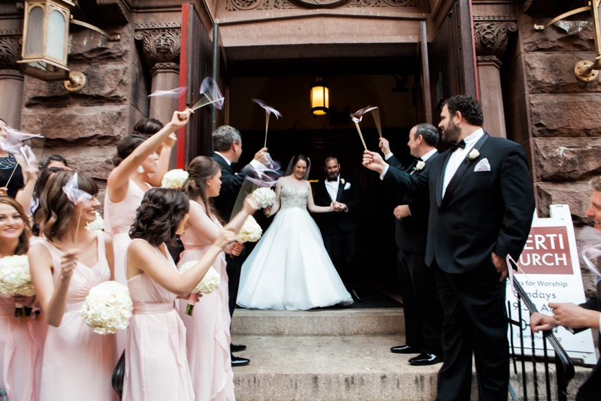Bride and groom exiting First Baptist Church of Philadelphia after ceremony.