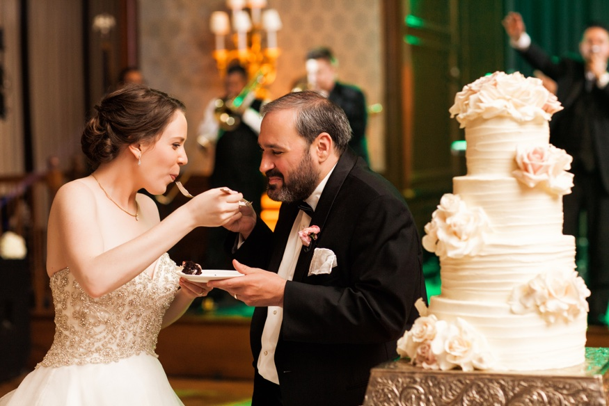 Bride and Groom cake cut at Union League wedding in Philadelphia.