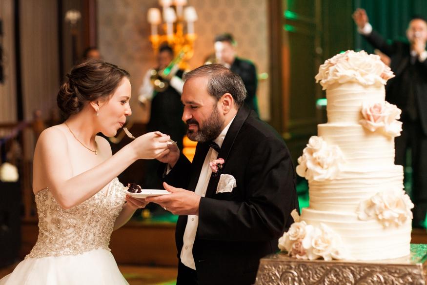 Bride and Groom cake cut at Union League wedding in Philadelphia.