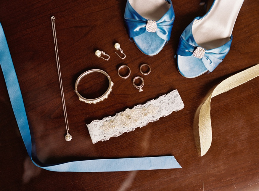 Bride's jewelry and wedding shoes.