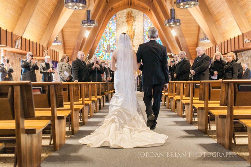 Bride walking down isle at St. Mary's Medford Lakes