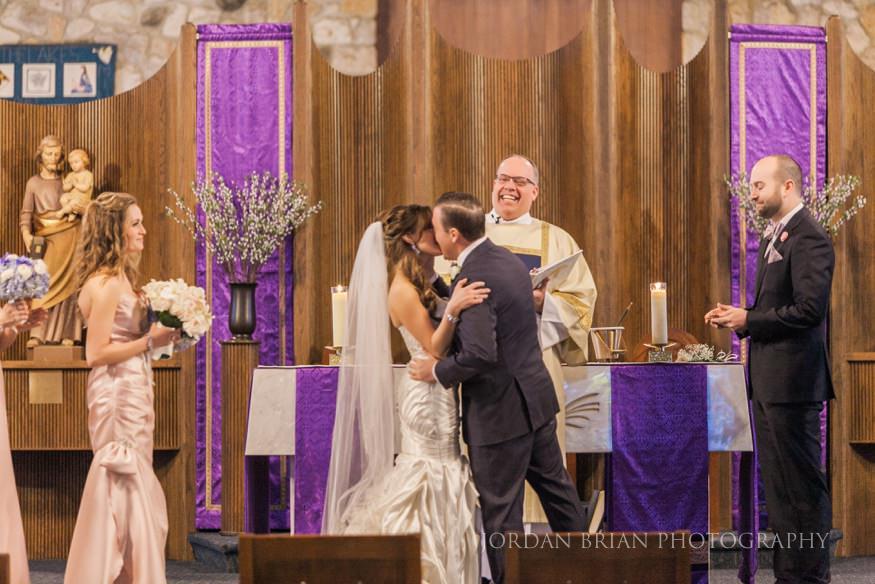 Ceremony kiss at St. Mary's Medford Lakes