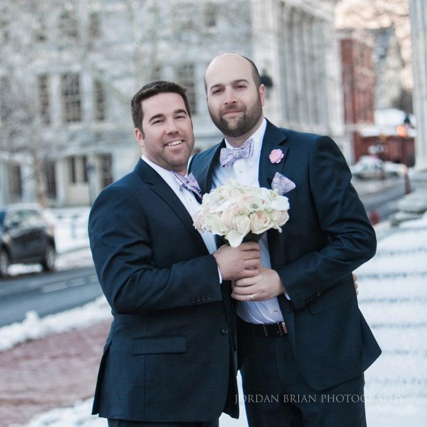 two men holding bouquet in Philadelphia
