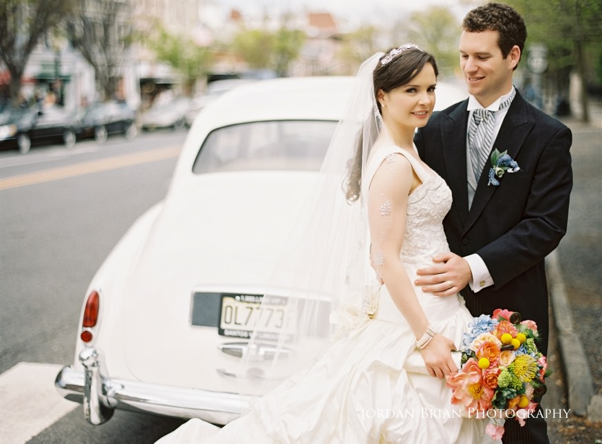 bride and groom in vintage car at grounds for sculpture wedding
