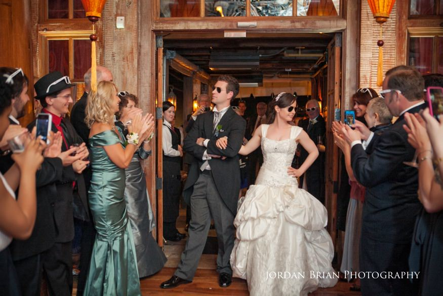 bride and groom entering reception at grounds for sculpture spring wedding