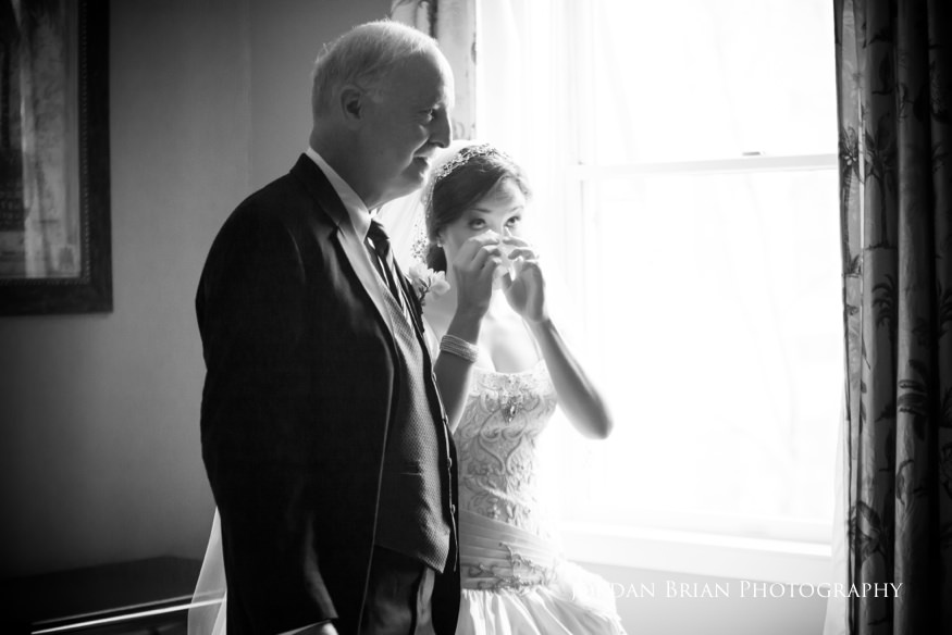 first look between father and bride before grounds for sculpture wedding