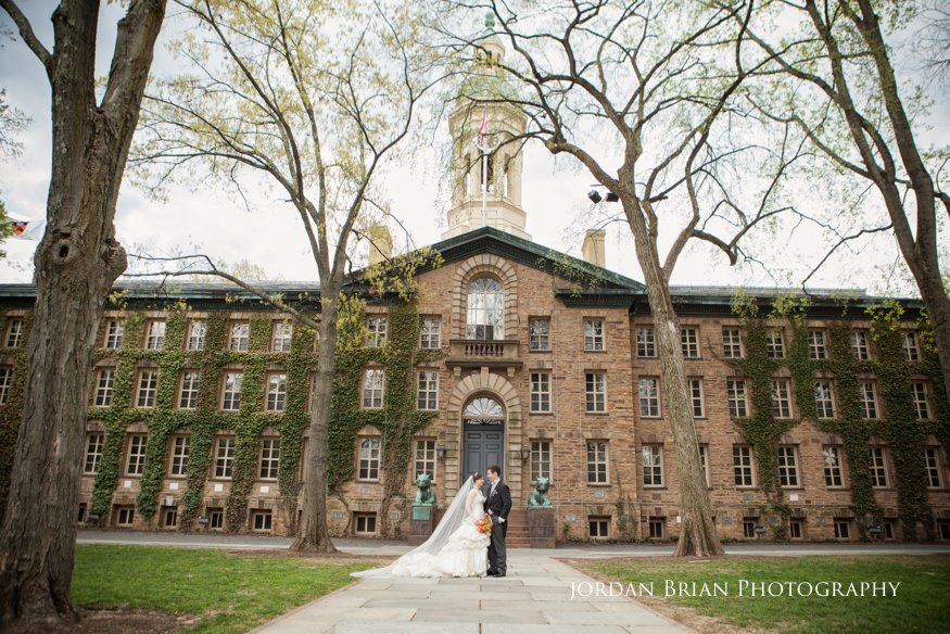 bride and groom in front of princeton university before grounds for sculpture wedding