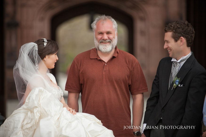 bride and groom photobomb with stranger in front of princeton university before grounds for sculpture wedding
