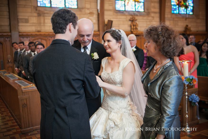 groom meeting bride at st paul's catholic church wedding ceremony in princeton nj
