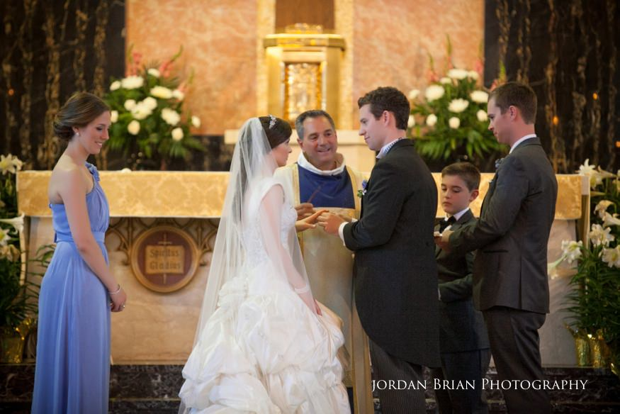 bride and groom exchange rings at st paul's catholic church wedding ceremony in princeton nj