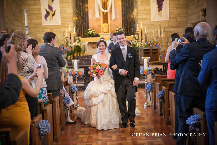 bride and groom leaving st paul's catholic church wedding ceremony