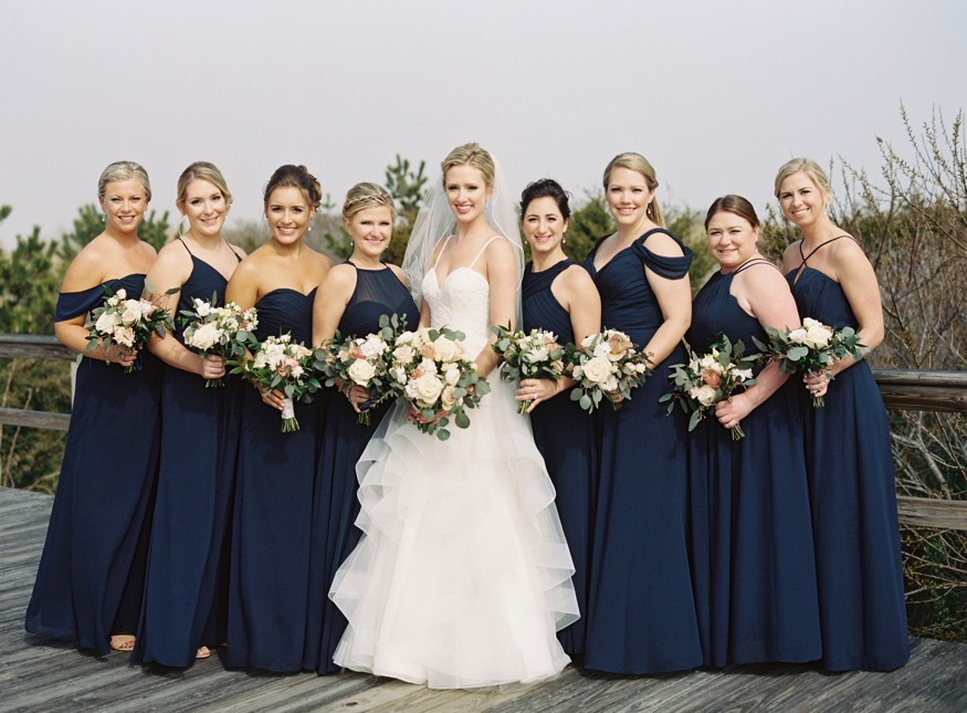 Bridal party portraits on Avalon Boardwalk before Icona Resort wedding.