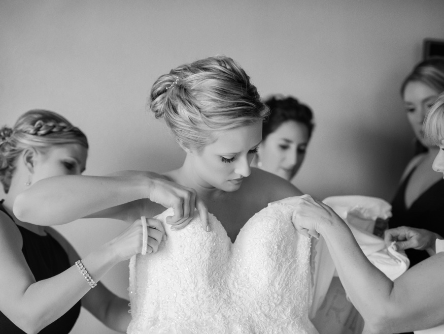 Bride getting ready in Stella York wedding dress at Icona Avalon wedding.