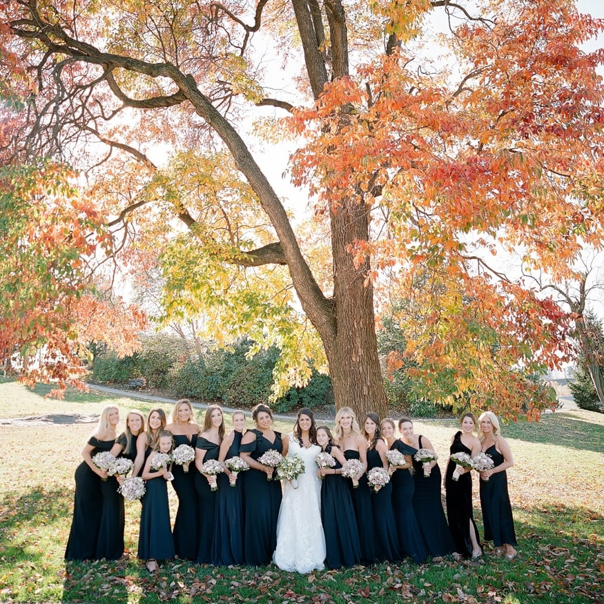 Fall wedding portraits of bridesmaids behind Philly Art Museum.