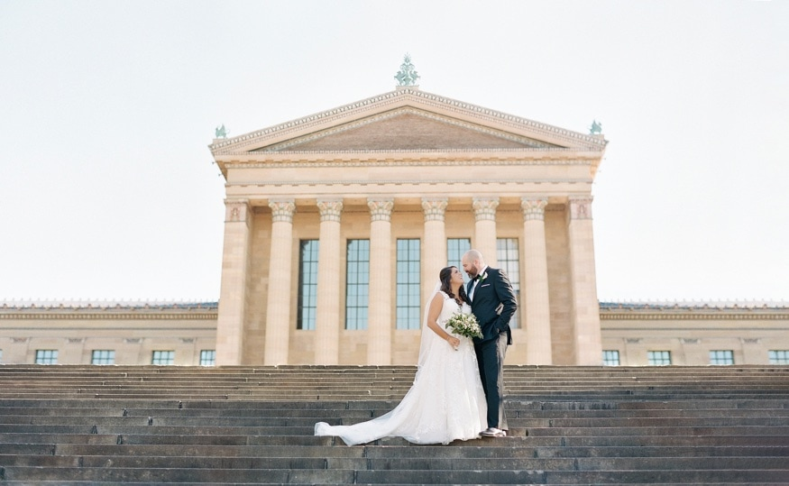Bride and groom on Art Museum steps in Philadelphia.