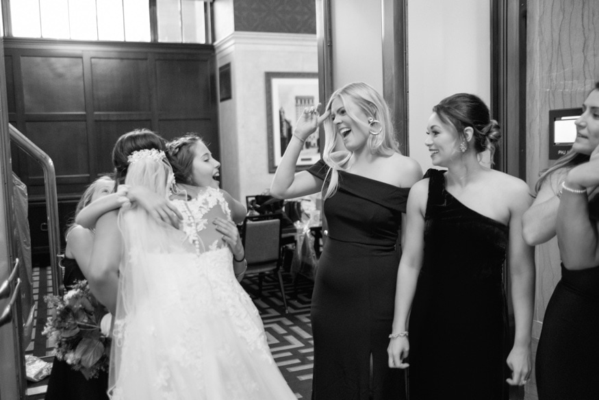 Bride's first look with Bridal Party at the Notary Hotel.