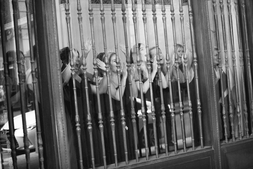 Bridesmaids watching first look at Notary Hotel.