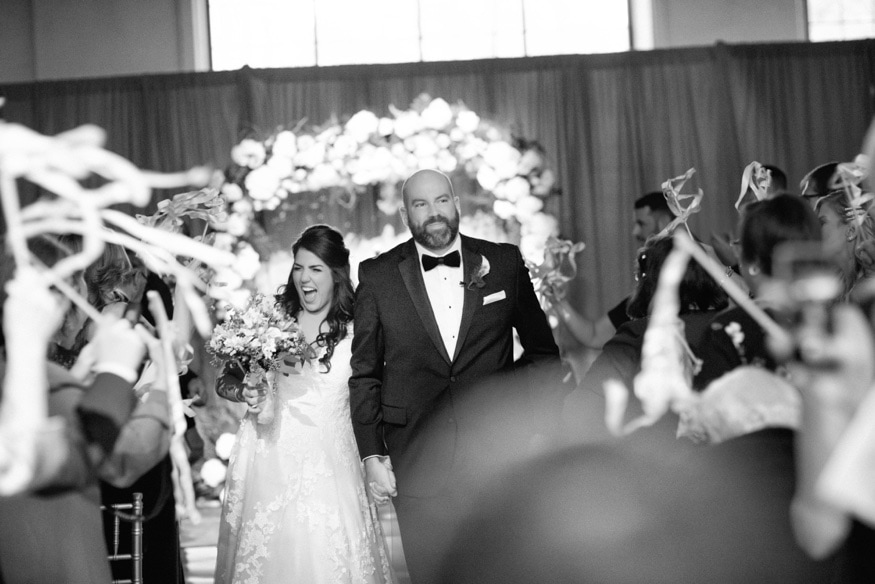 Bride and groom exiting wedding ceremony at Moulin Philadelphia.