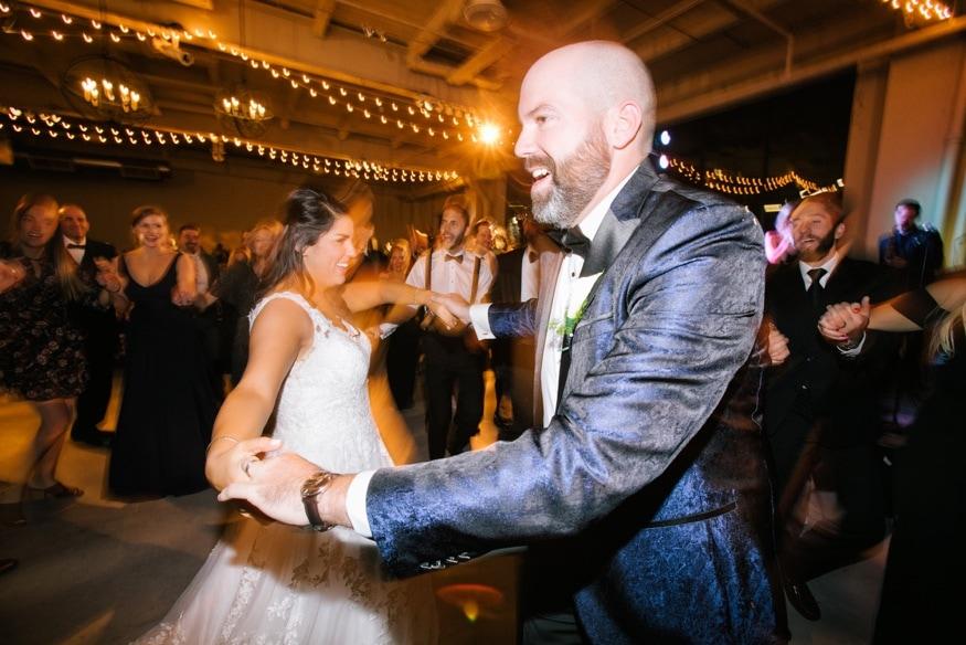 Bride and groom dancing the horah at Moulin Philadelphia wedding.