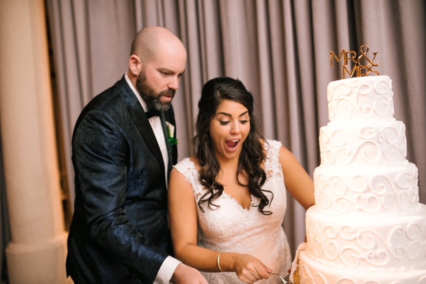 Bride and groom cut the cake from Isgro Bakery at Moulin by Brulee Catering wedding reception.