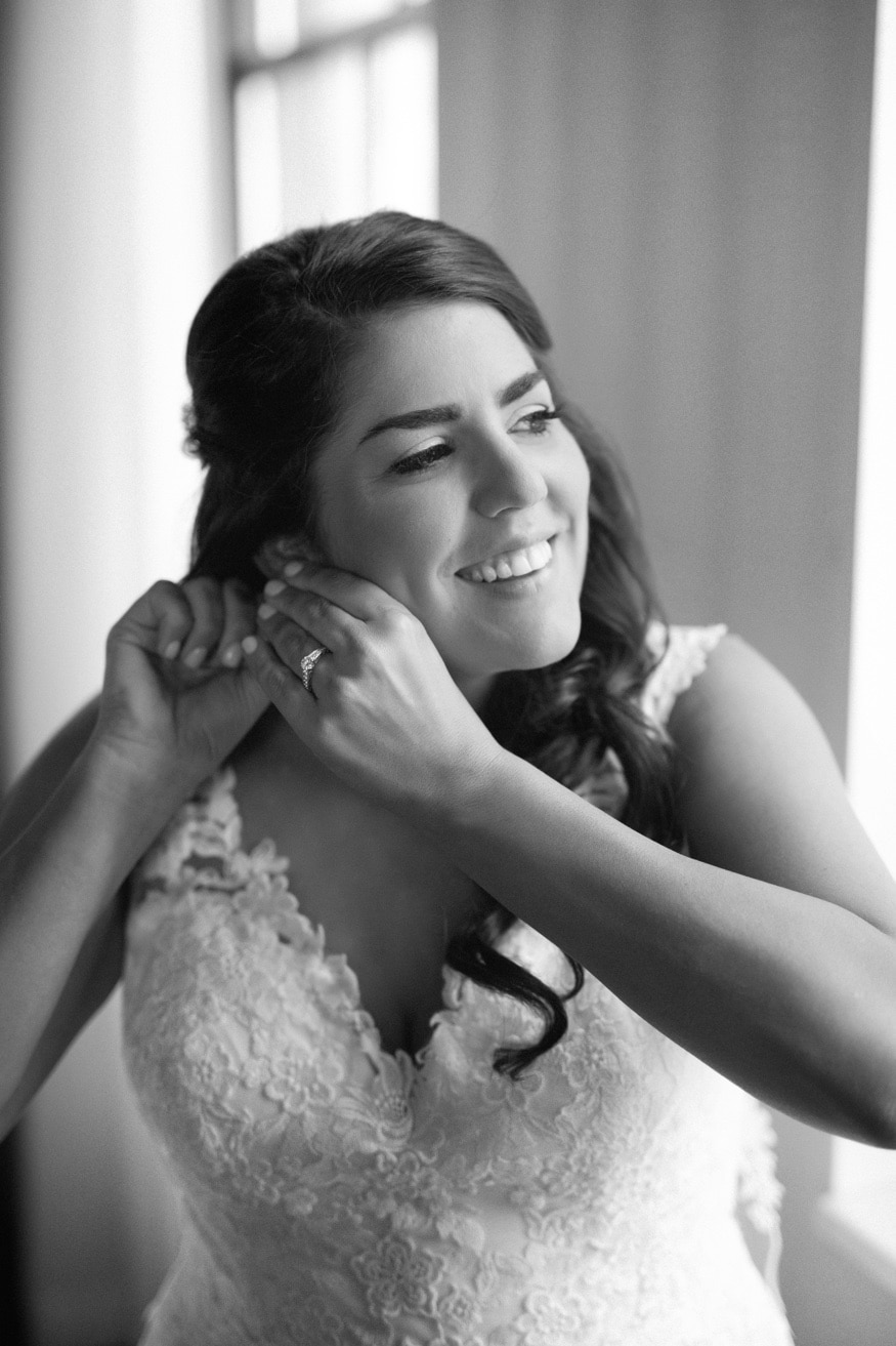 Bride getting ready before wedding at Moulin at Sherman Mills.