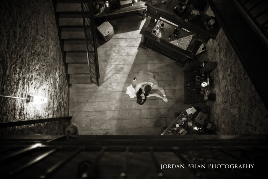 bride and groom dancing in wine cellar at knowlton mansion