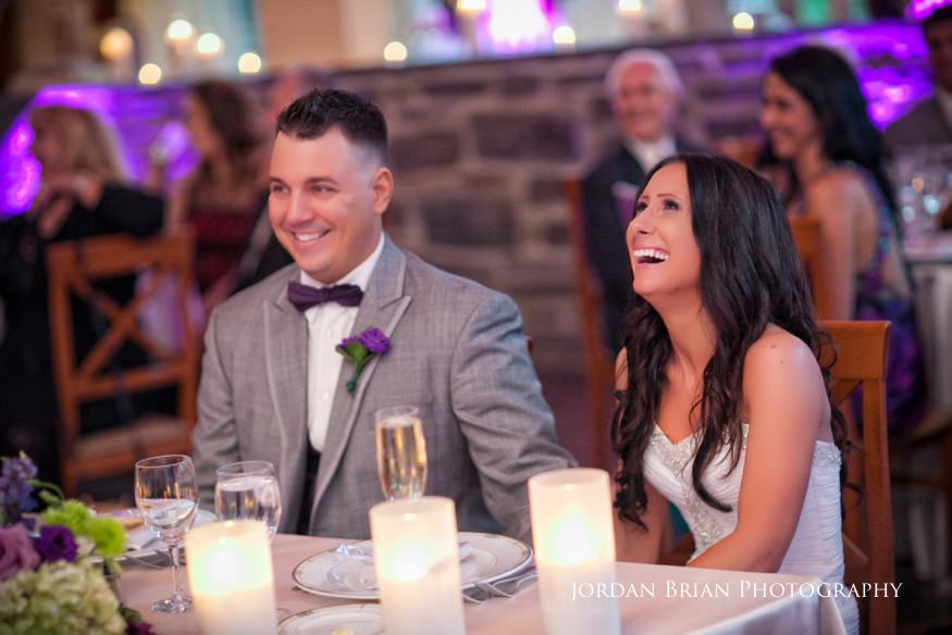 bride and groom laughing at wedding reception at knowlton mansion