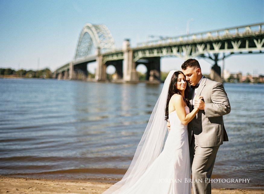 bride and groom portrait infront of tacony palmyra bridge