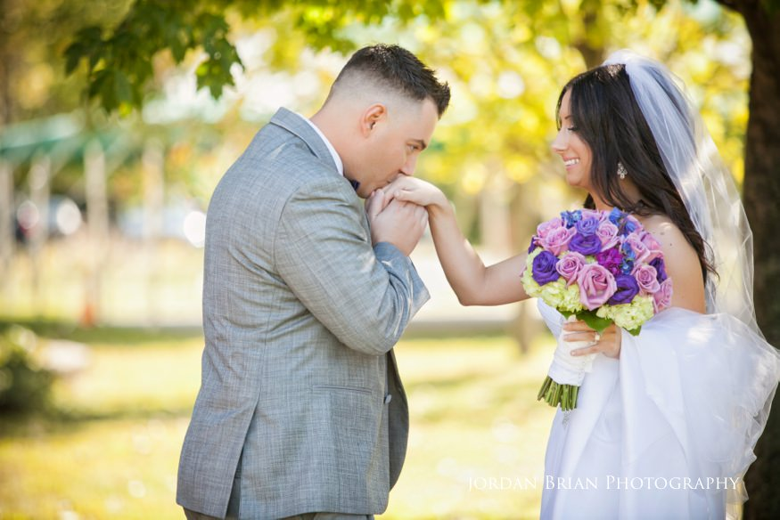 groom kissing bride at first look